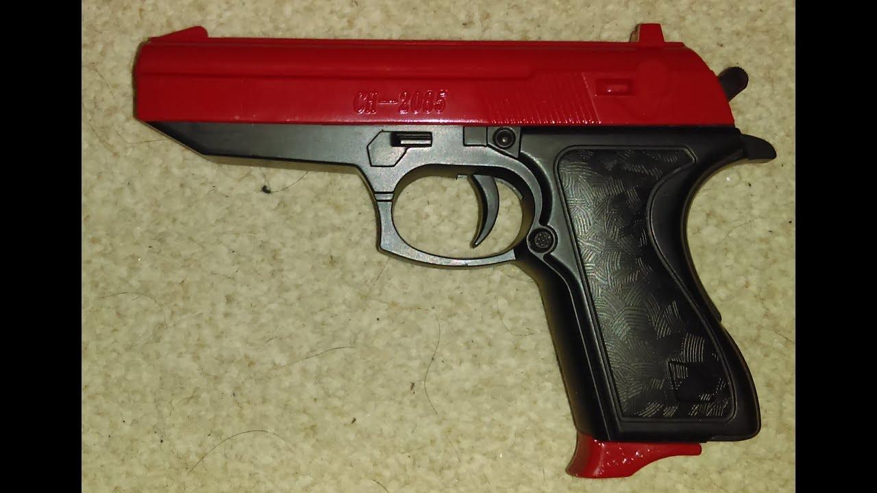 Revue Airsoft du pistolet à ressort Walther PPK avec une glissière rouge (CH 2085)
