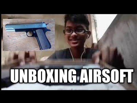 unboxing pistolet Airsoft et revue pistolet Colt 45