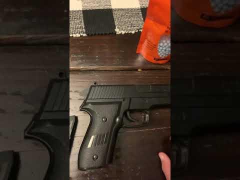 Revue du dessus de table P228 Airsoft Pistol (à ressort)