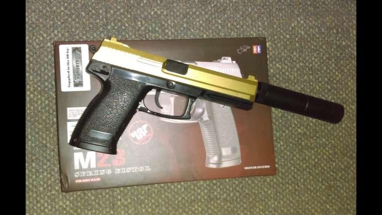 Unboxing et examen Airsoft du pistolet M23 USP à ressort de Double Eagle (glissière d'or)
